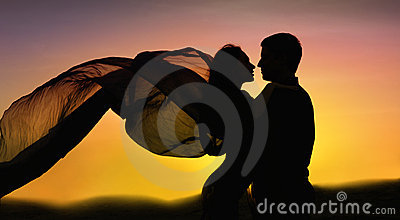Couple in love dancing at sunset