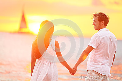 Couple in love happy at romantic beach sunset