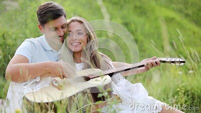 Couple In Love On Nature, Man Teaching Woman Playing In Guitar stock footage
