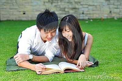 Couple In Love Reading Book In The Park