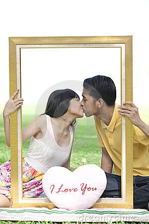 Couple in love with rectangle frame