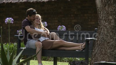 Couple in love. Couple sitting on a bench stock video