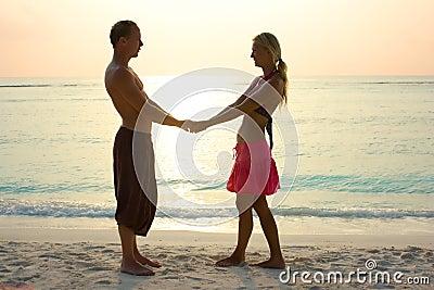 Couple in love in sunrise