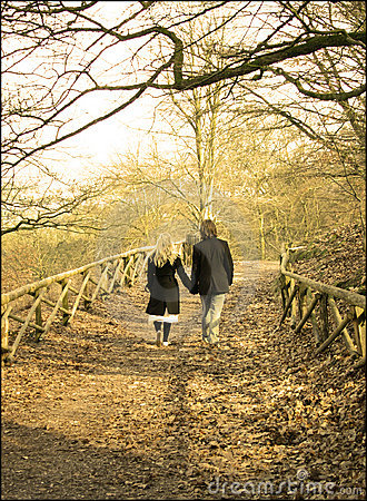 Free Couple, Lovers In The Forest Holding Hands Royalty Free Stock Images - 663749