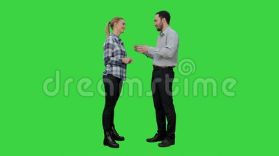 Couple of lovers stand, talk, laugh on a Green Screen, Chroma Key. 076. You can use it e.g. in your commercial video, business, medical presentation, broadcast stock footage