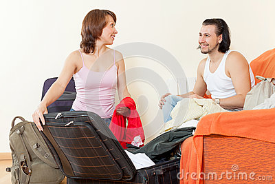 Couple with luggage in the house is going to leave a dizzying