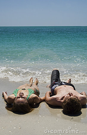 Couple Lying on Beach