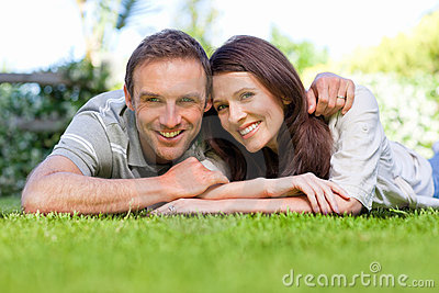 Couple lying down in the garden