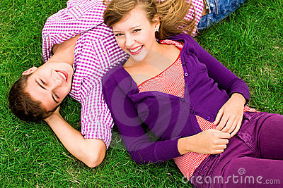 Couple lying down on grass