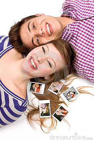 Couple lying down with polaroid pictures
