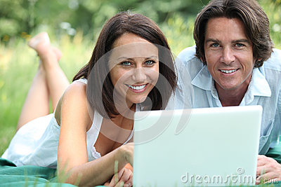 Couple with lying in the grass