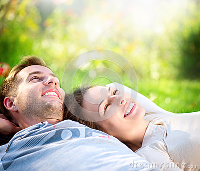 Couple Lying on Grass Outdoor