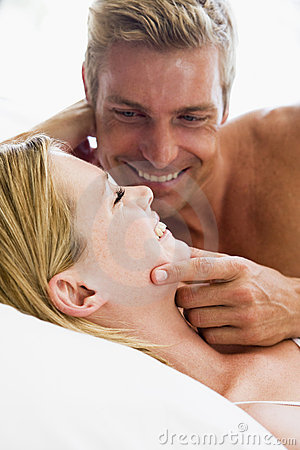 Free Couple Lying In Bed Smiling Stock Images - 5760274