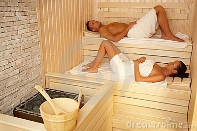 Couple lying in sauna