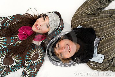 Couple lying in snow