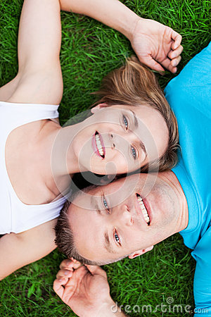 Couple lying together head to head