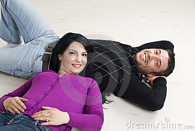 Couple lying on wooden floor
