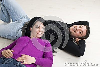 Couple lying on wooden floor