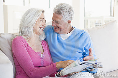 Couple with a magazine smiling