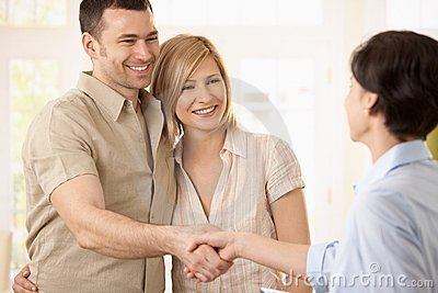 Couple making deal with agent