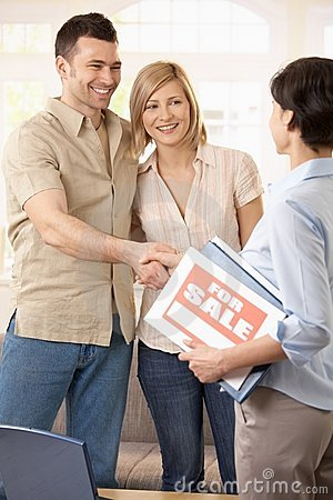 Couple making deal with estate agent