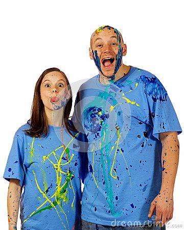 Couple making faces at the camera after a paint wa
