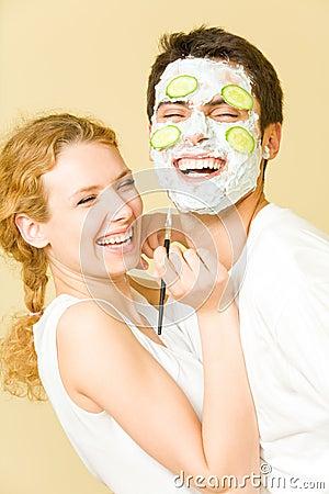 Couple making facial masque