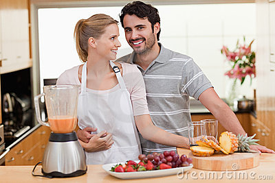 Couple making fruits juice