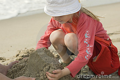 Couple making a sand castle