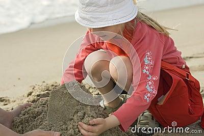 Couple making a sand castle