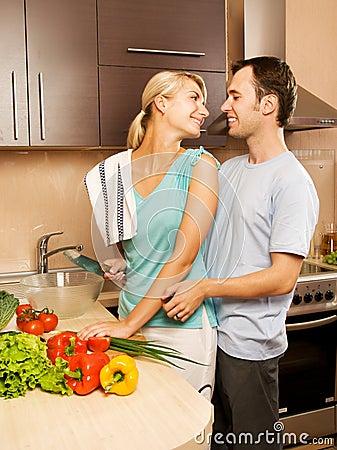 Couple making vegetable salad