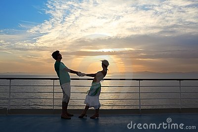Couple: man with woman on deck of cruise ship