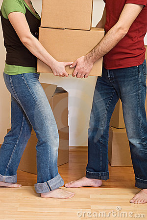 Couple, man and woman, moving cardboard boxes