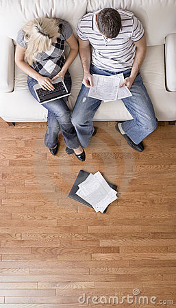 Free Couple Managing Personal Finances Royalty Free Stock Images - 12564569