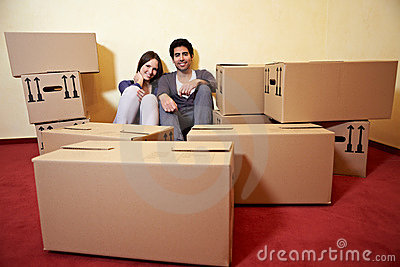 Couple between many moving boxes