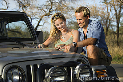 Couple With Map on Car Hood