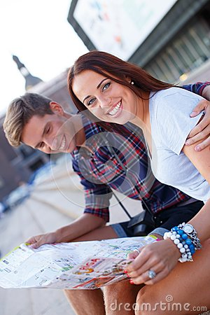 Couple with map outdoors