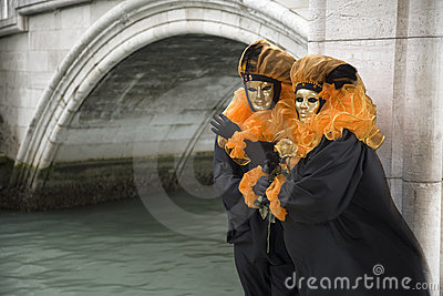 Couple of masks at bridge in Venice