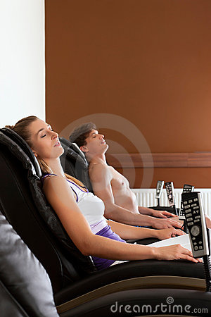 Couple on massage chair in gym
