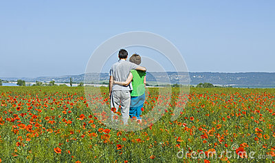 Couple on meadow with poppies