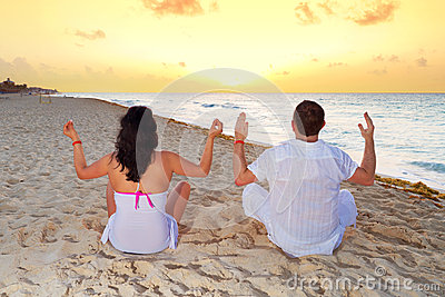 Couple meditating together on the Caribbean Sea