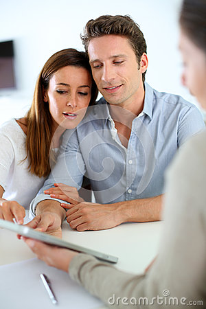 Couple meeting real estate agent