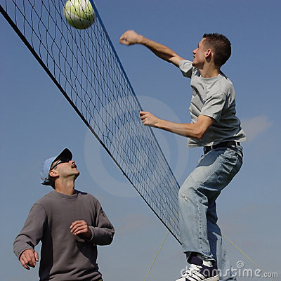 Couple men playing volleyball