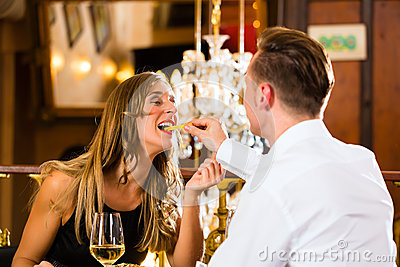 Happy couple in restaurant eat fast food