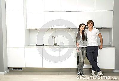 Couple in modern kitchen