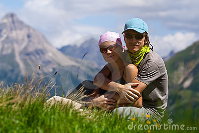 Couple in mountains looking at camera