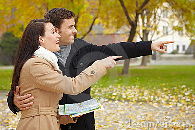 Couple navigating with city map
