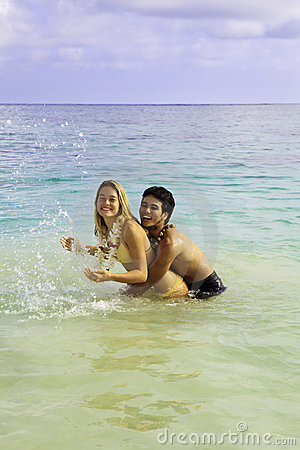 Couple in the ocean in hawaii