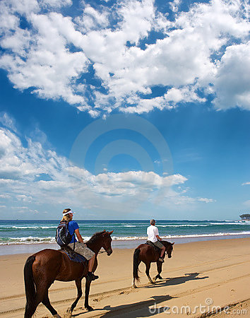 Free Couple Of Horse Riders On Beach Royalty Free Stock Images - 6437159