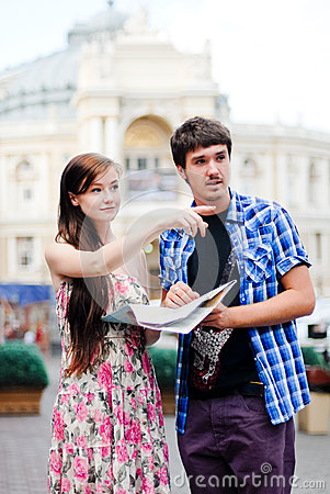Free Couple Of Tourists Looking On Map In City Centre Royalty Free Stock Photo - 26128965